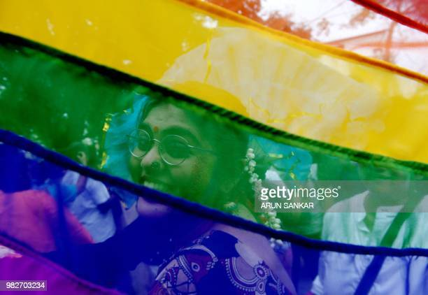 An Indian supporter of the lesbian gay bisexual transgender community takes part in a pride parade in in Chennai on June 24 2018