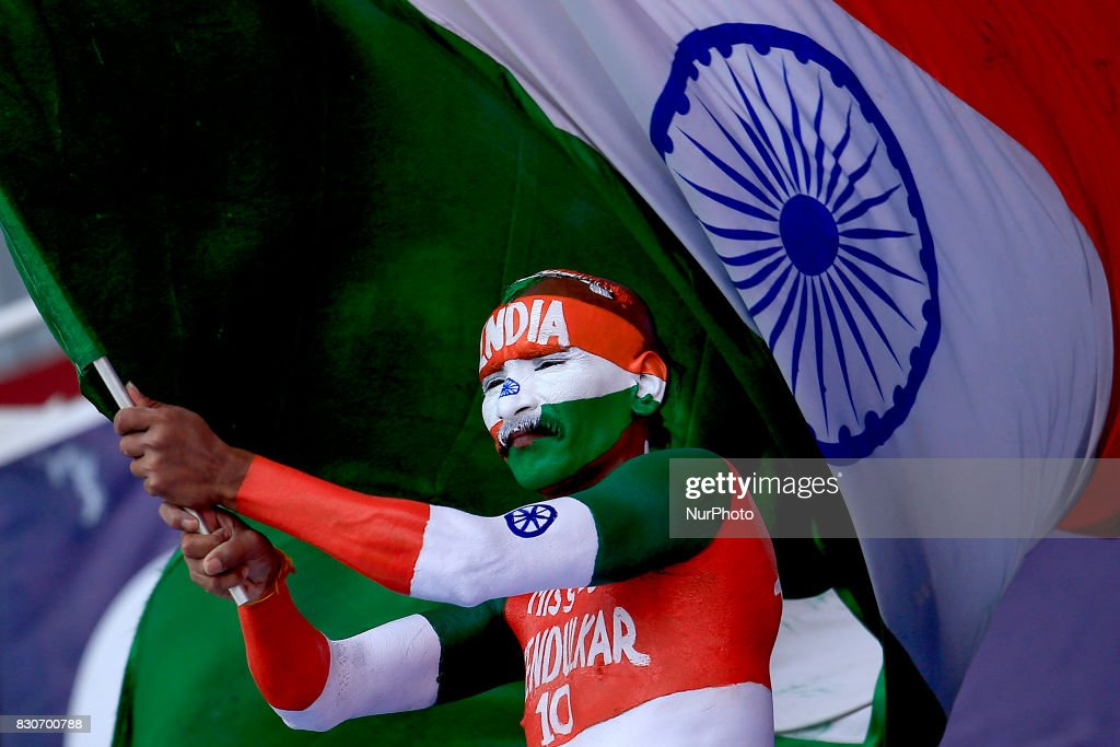 An Indian supporter waves the Indian national flag during the 1st Day's play in the 3rd Test match between Sri Lanka and India at the Pallekele International cricket stadium, Kandy, Sri Lanka on Saturday 12 August 2017.