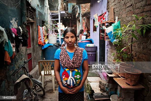 An Indian surrogate mother stands in the alley of a Mumbai ghetto where her room is located A clinic in Mumbai called 'Surrogacy India' have rented a...