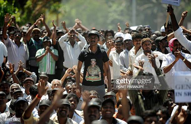 An Indian Tamil man wears a tshirt with a picture of slain Liberation Tigers of Tamil Eelam leader Velupillai Prabhakaran during a protest rally...