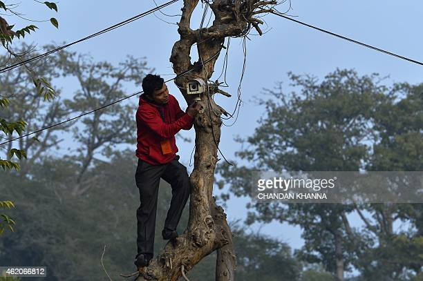 An Indian technician checks the CCTV camera at the roadside near the Presidential Palace as preparations for the nation's Republic Day parade take...