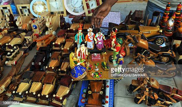 An Indian tourist looks at a toy at Channapatna's showroom in Bangalore on November 12 2010 Channapatna toys are a particular form of wooden toys...