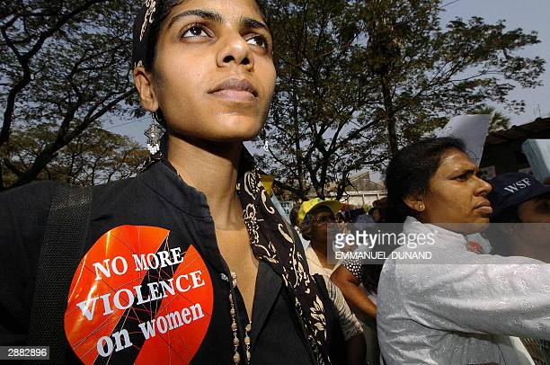 An Indian transexual delegate joins a protest against violence against women after a delegate to the 2004 World Social Forum was accused of raping a...