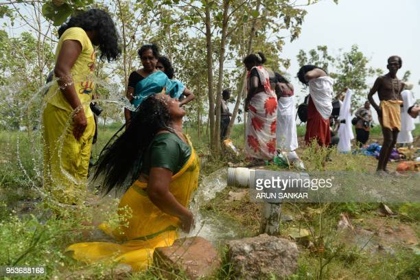 An Indian transgender devotee bathes after a ritual signifying their marriage to the Hindu warrior god Aravan at the Koothandavar Temple in the...
