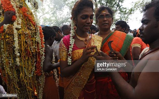 An Indian transgender devotee reacts as a Hindu priest removes her 'thali' sacred thread and bangles following a ritual signifying their marriage to...