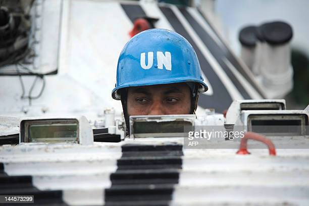 An Indian United Nations peacekeeper sits in an armoured infantry fighting vehicle at a temporary operating base in Bunagana, a border town in the...
