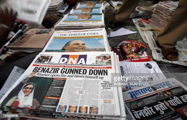 An Indian vendor arranges newspapers in Mumbai early 28 December 2007 with the reports of the assassination of former Pakistani premier Benazir...