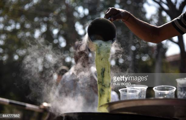 An Indian vendor prepares Ghuta a drink made from marijuana and milk for sale on the occasion of the Maha Shivaratri festival at The Lord Shiva...