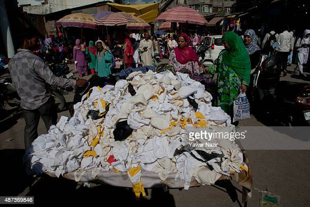 An Indian vendor sells bras on a road on September 09 2015 in Srinagar the summer capital of Indian administered Kashmir India Kashmir the Muslim...