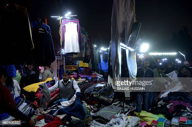 An Indian vendor sells clothes at a roadside stall in New Delhi on January 28 2015 India's economy grew 47 percent in 2014 and the Central bank...