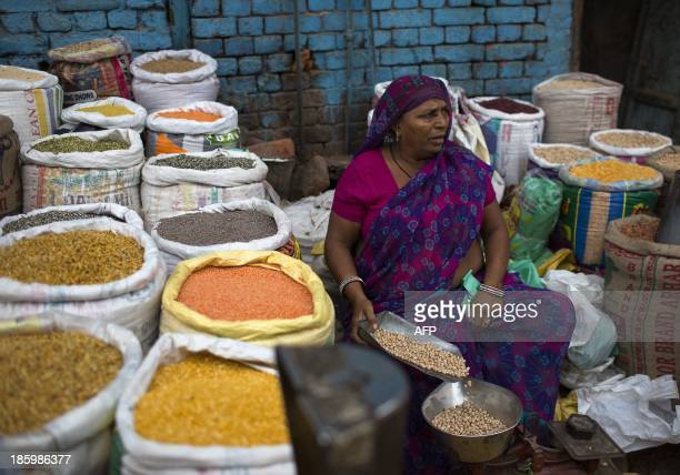 An Indian vendor sells dried goods on a street in the Old Quarter of New Delhi on October 27 2013 India the world's second most populous nation is...