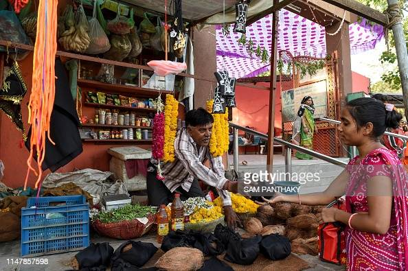 An Indian vendor sells religious items to Hindu devotees