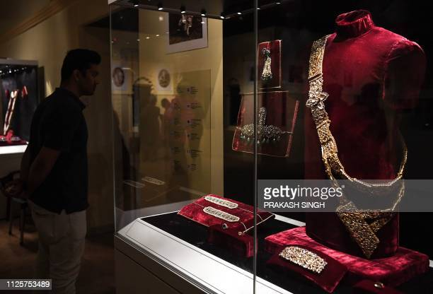 An Indian visitor looks at the jewellery displayed at the 'Jewels of India The Nizam's Jewellery Collection' exhibition at the National Museum in New...