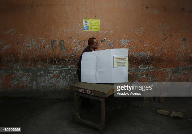An Indian voter casts his ballot at a polling station in New Delhi on February 7 2015