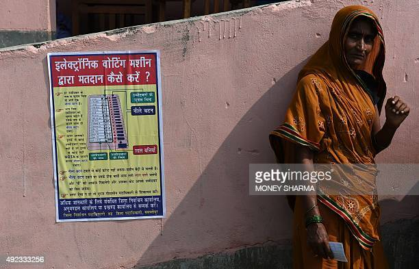 An Indian voter waits to cast her ballot at a voting centre in the village of Mahmoodpur in Samstipur district on October 12 2015 The first of five...