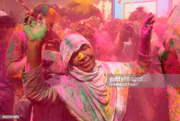 TOPSHOT An Indian widow dances during celebrations for Holi or 'festival of colors' in Vrindavan on March 9 2017 Widows congregated on a small patio...