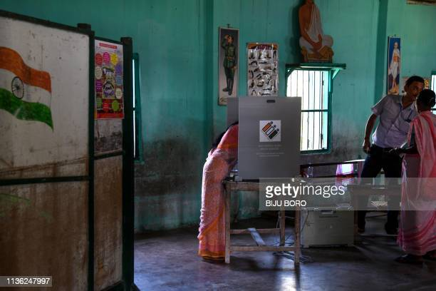 An Indian woman casts her vote at a polling station during India's general election in Salna Tea Estate some 170 km from Guwahati the capital city of...