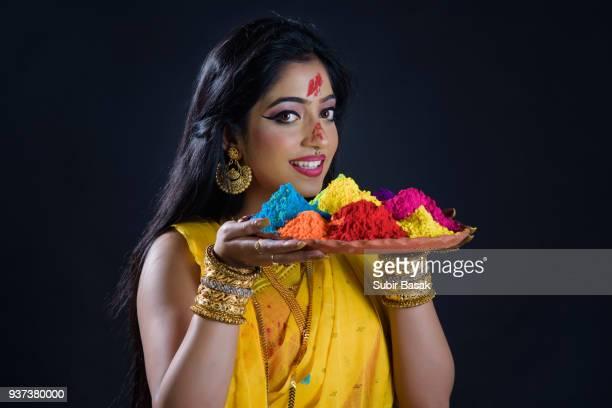 An Indian woman celebrating holi festival.