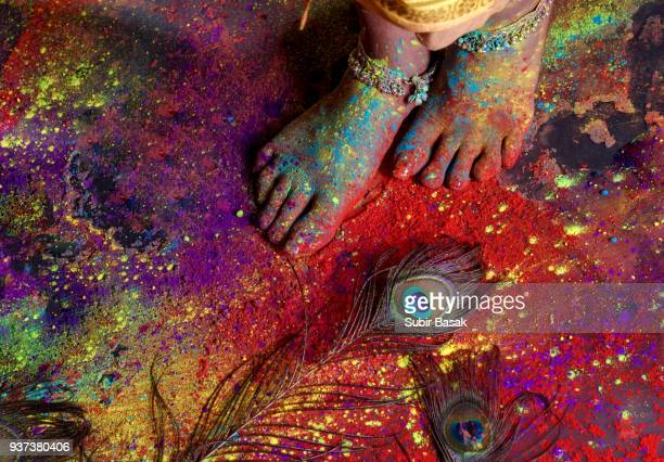 an indian woman celebrating holi festival. - indian female feet stock pictures, royalty-free photos & images