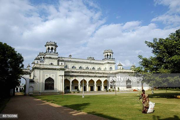 An Indian woman collects leaves fallen on the lawns of the Chowmahalla Palace in the old city of Hyderabad on 19 November, 2008. Nizam Salabhat Jung...