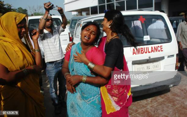 An Indian woman cries at a hospital after a stampede in Kunda near Pratapgarh village in Uttar Pradesh state some 65 km from Allahabad on March 4...
