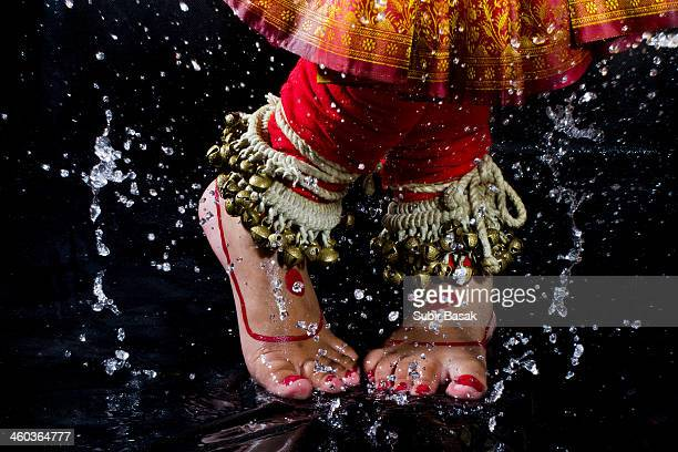 An Indian woman dancing during rain