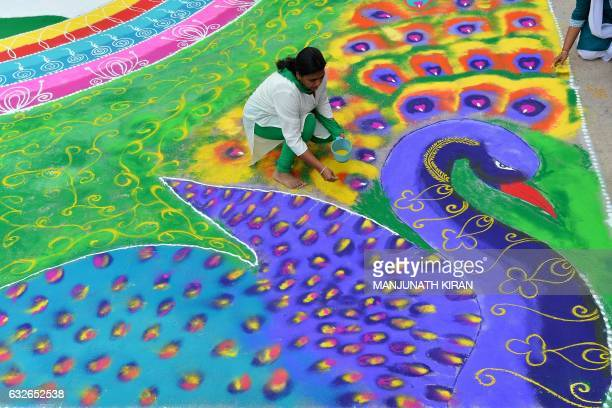 An Indian woman draws a 'rangoli' on the eve of the 68th Indian Republic Day celebrations in Bangalore on January 25 2017 'Rangoli' is a traditional...