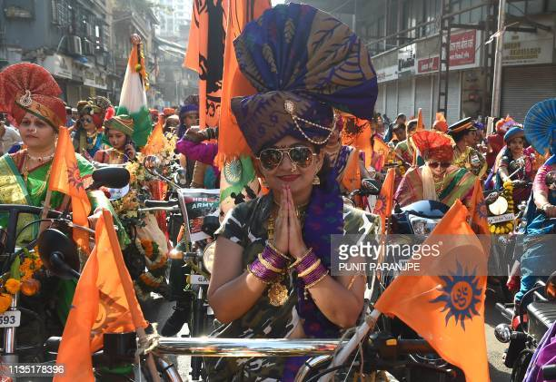 An Indian woman dressed in traditional attire poses for a picture as she takes part in a procession celebrating 'Gudhi Padwa' or the Maharashtrian...
