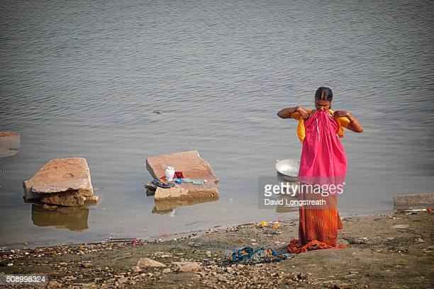 An Indian woman finishes bathing in the Ganges river Hindus consider the river sacred It serves as a lifeline to countless people who live along its...