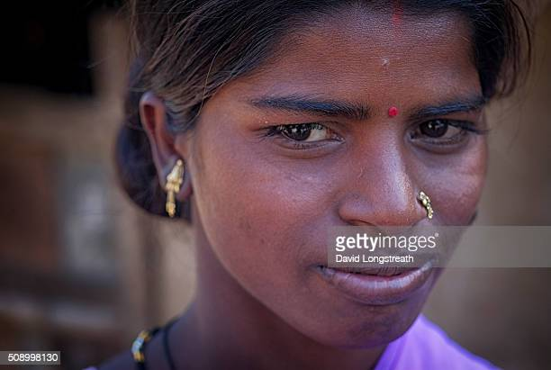 An Indian woman from a poor rural village looks on