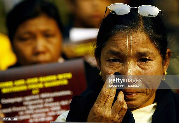 An Indian woman from the northeastern state of Manipur breaks down as she takes part in a protest in New Delhi 25 January 2008 Activists of various...