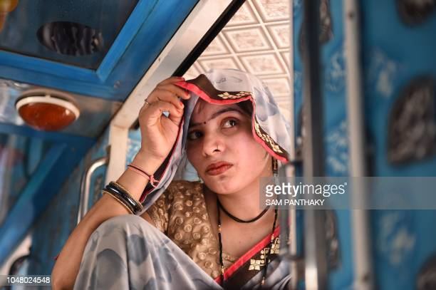 An Indian woman from Uttar Pradesh state sits inside a bus as she leave Ahmedabad on October 9 2018 Indian police said on October 8 at least 421...