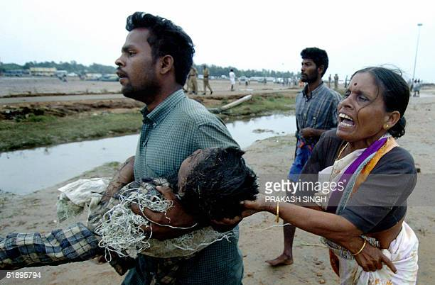 An Indian woman grieves as the body of her dead son is carried to a mass burial site at Silver Beach in Cuddaloresome 185 kms south of Madras 27...