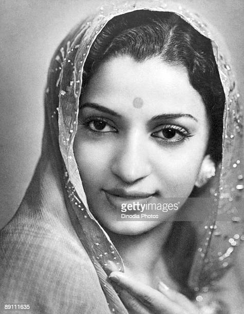 An Indian woman in traditional headscarf and wearing a bindi Kulri Mussoorie Uttar Pradesh India 1940's Photo by Dinodia/Getty Images