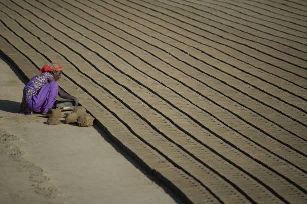 TOPSHOT An Indian woman makes bricks at brick kiln in Jalandhar on March 7 ahead of International Women`s Day International Women`s Day is celebrated.