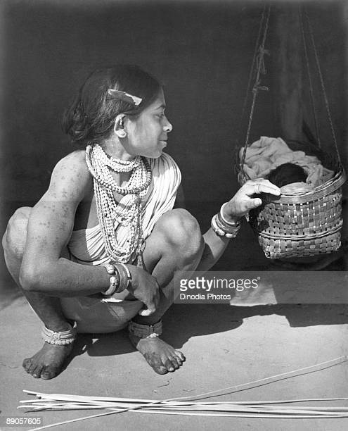 An Indian woman of the Muria tribe with her baby Bastar Chhattisgarh state India 1940's