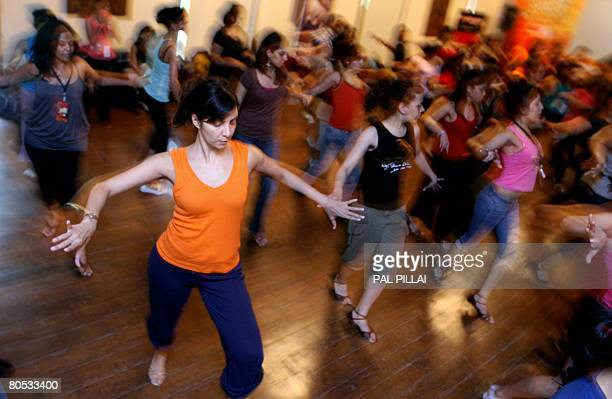 An Indian woman practises Salsa moves at a workshop in Mumbai on April 5 2008 Salsa already an international dance craze across several countries is...