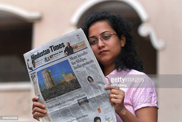 An Indian woman reads Hindustan Times an Indian newspaper in Mumbai India on Thursday Jan 18 2007 The UK and Indian governments condemned alleged...