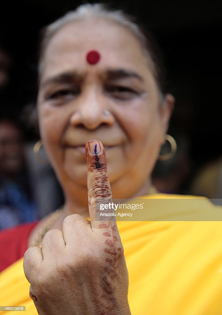 An Indian woman shows her ink-stained finger after casting her ballot during the sixth phase of the Indian parliamentary elections in Mumbai on April 24, 2014. The second-biggest day of Indias parliamentary election begins on Thursday with 11 states and one federal territory going to the polls for 117 seats.