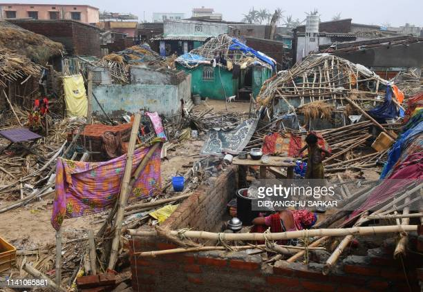 TOPSHOT An Indian woman sits in the debris with a child in a stormdamaged building in Puri in the eastern Indian state of Odisha on May 4 after...