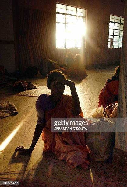 An Indian woman survivor from the Sonakupam, a fishing village destroyed by Tsunami, waits at the Alaganda temporary shelter at Cuddalore 180...