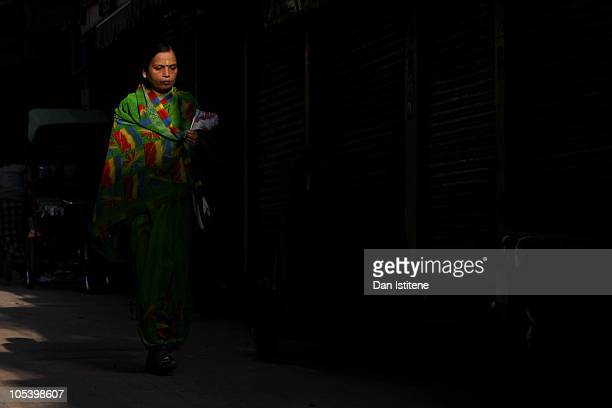 An Indian woman walks down a street in Old Delhi on October 14 2010 in Delhi India An investigation into corruption is expected to follow the end of...