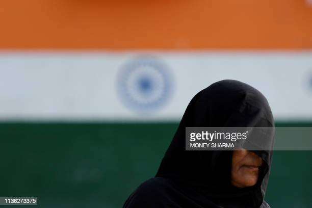 TOPSHOT An Indian woman walks out of a polling station after casting her vote during India's general electionin in Khatauli in the northern Indian...