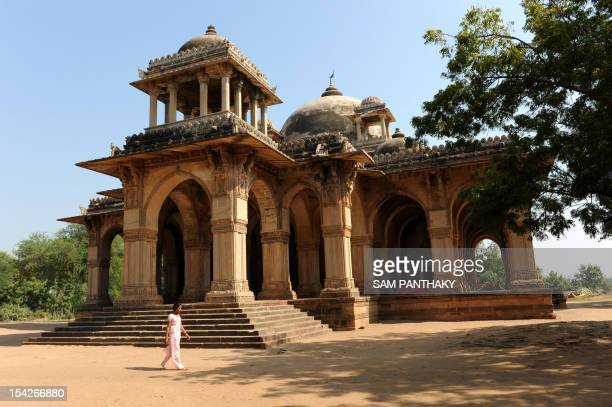 An Indian woman walks past the tomb of Mubarak Sayyid in Sojali village some 35 km from Ahmedabad on November 20 2009 Sultan Mahmud Begada built a...