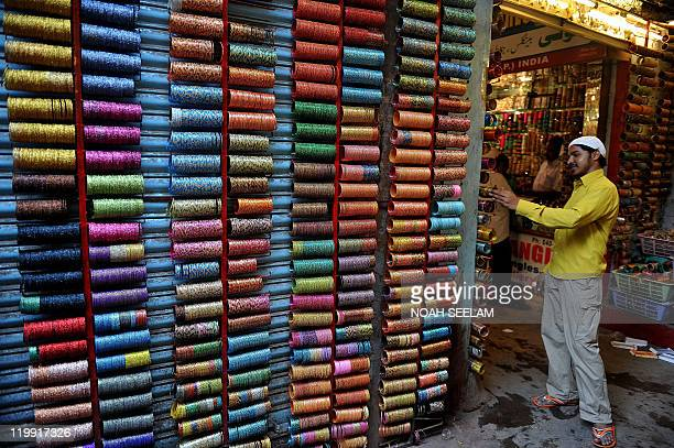 An Indian worker arranges a display of bangles at a shop in Lad Bazaar in Hyderabad on July 21 2011 Lad Bazaar once known only as a tourist...