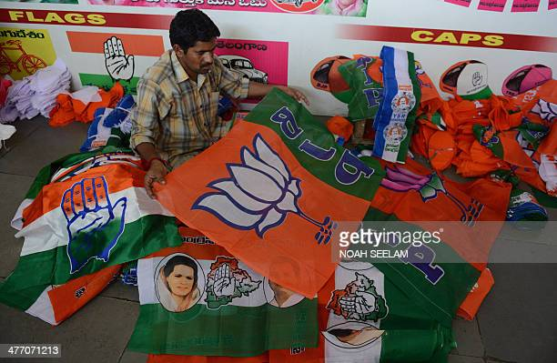 An Indian worker folds and separates different political party campaign flags at a workshop in Hyderabad on March 7 2014 India the world's largest...