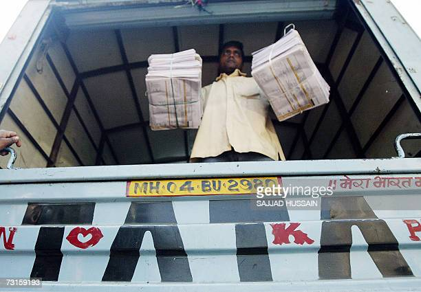 An Indian worker loads goods onto a Tata commercial vehicle in south Mumbai business district 31 January 2007 India's Tata Steel said the acquisition...