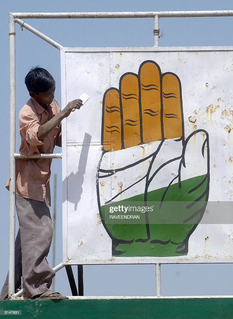 An Indian Worker Paints A Congress Party Pictures Getty Images