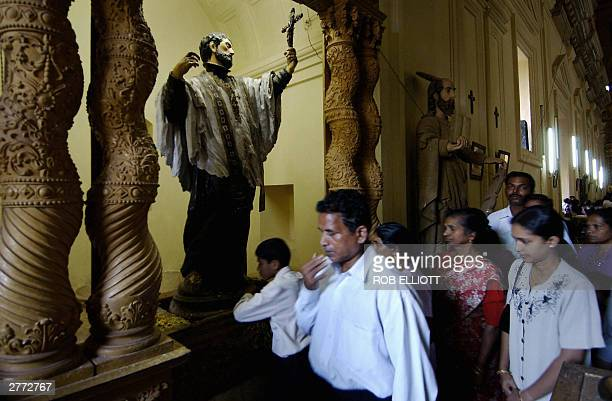 An Indian worshipper gestures after touching the feet on the statue of Saint Francis Xavier in the Saint Francis Xavier Church in Old Goa some 615...