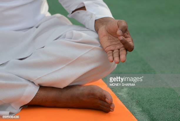 An Indian yoga practitioner participates in a mass yoga session on International Yoga Day in New Delhi on June 21 2017 Yoga has connected the world...